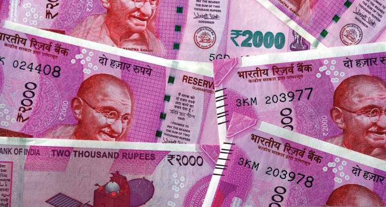 Indian Rupee slumps 33 paise to close at record low of 74.39