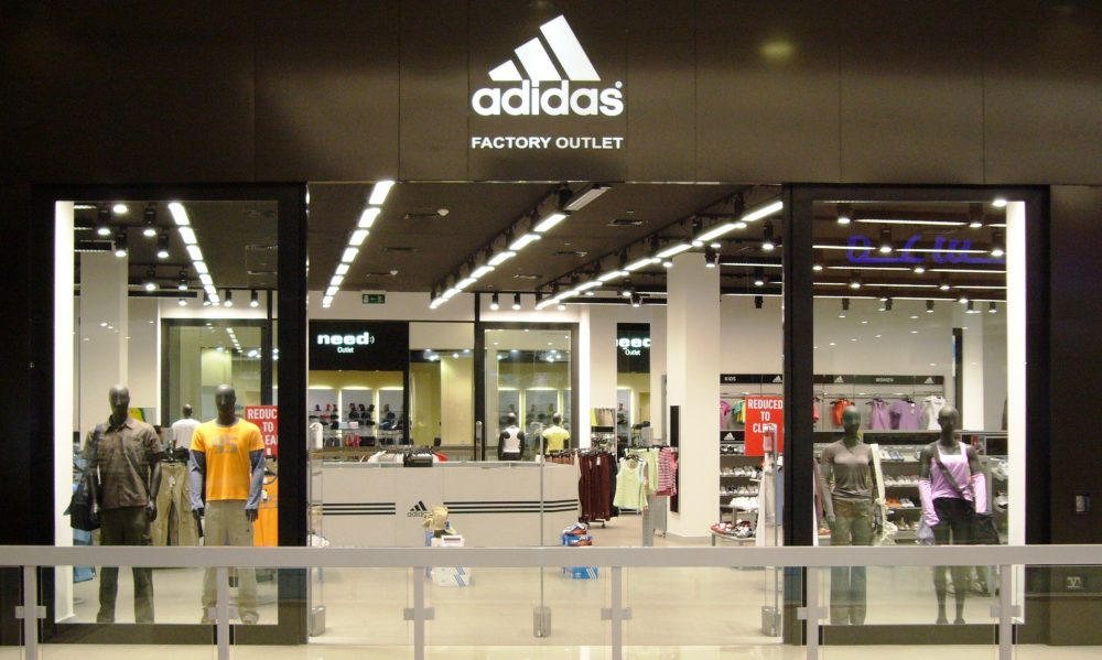 Adidas misses forecasts with 93% profit plunge, warns on sales